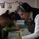 Sister Janice tutors Deonte Broughton in math during an after-school program