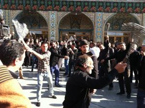Shite men remember Imam Hussain Ali at The Fatima al-Masumeh Shrine, Qom